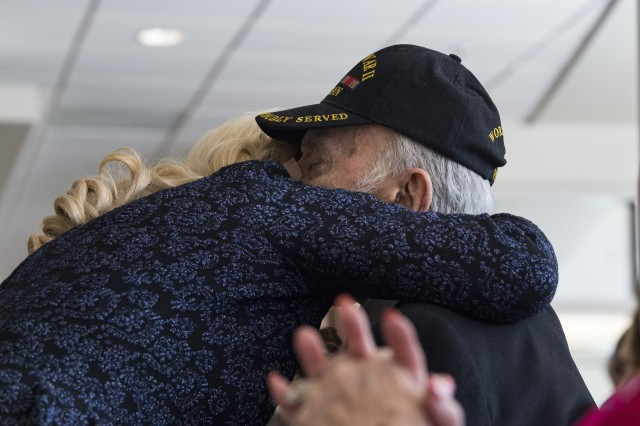 George Aigen, and his daughter Judy Hathcock, embrace during a pinning ceremony, April 11, 2019, in Valdosta, Ga. George Aigen was bestowed the highest honor in France: induction into the French Legion of Honor as a knight, or chevalier, for his actions during World War II. In April 1945, as a 19-year-old Army corporal, Aigen fought alongside other Soldiers in 1269th Combat Engineers Company B and was part of the group who liberated Dachau, the first concentration camp built by the Nazis in 1933.