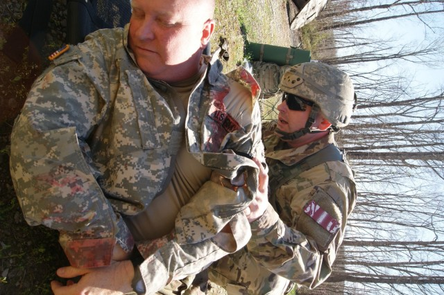 An Army Reserve Soldier performs basic first aid to a mock patient during the 2019 Combined Best Warrior Competition held at Fort Knox, Kentucky, April 7-12. The 80th Training Command, 84th Training Command, 377th Theater Sustainment Command, 88th Readiness Division, 81st Readiness Division, 99th Readiness Division, Army Reserve Aviation Command, and AR Careers Division joined their resources in creating this year's competition.