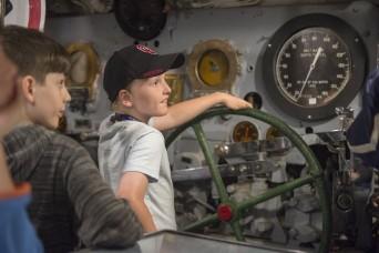 Military children experience a night at the U.S.S. Batfish