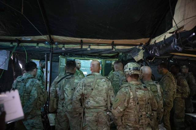 Col. Charles S. Armstrong, commander, 1st Armored Brigade Combat Team, 1st Infantry Division, briefs Soldiers from 2nd Battalion, 34th Armored Regiment, 1st Armored Brigade Combat Team, during exercise Allied Spirit X in Hohenfels, Germany, April 8, 2019. The 1st ABCT is part of more than 6,000 U.S. regionally-allocated Soldiers in Germany, Bulgaria, Estonia, Hungary, Latvia, Lithuania, Poland and Romania, on a nine-month rotation, in support of Atlantic Resolve. Exercise Allied Spirit X includes approximately 5,600 participants from 15 nations, March 30-April 17, 2019, at the 7th Army Training Command's Hohenfels Training Area in Southeastern Germany.