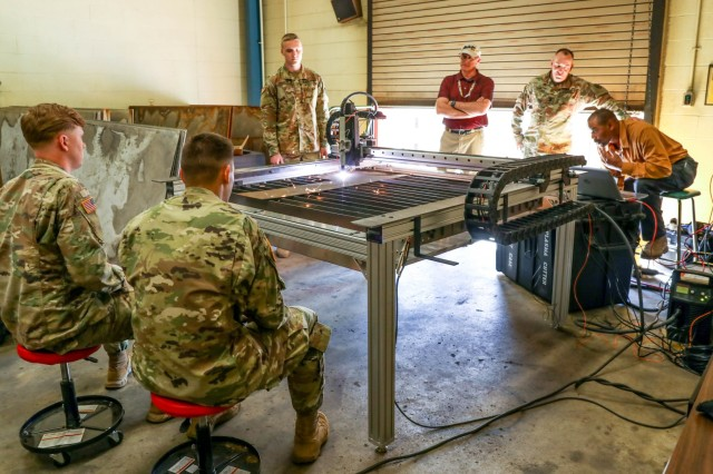 Soldiers of the 584th Maintenance Company, 129 Combat Sustainment Support Battalion, 101st Sustainment Brigade, 101st Airborne Division (Air Assault), and watch attentively as civilian engineering instructors demonstrate how to use the plasma cutter machine to cut through sheet metal. The plasma cutter is one of many pieces of equipment housed within the Metal Working and Machining Shop Set (MWMSS) given to the 584th MC, who base their operations out of Fort Campbell, Kentucky, April 3-12, 2019. The 584th MC will be the first company within the 101st Abn. Div. to receive this new and innovative equipment. (U.S. Army photo by Staff Sgt. Caitlyn Byrne, 101st Sustainment Brigade Public Affairs)