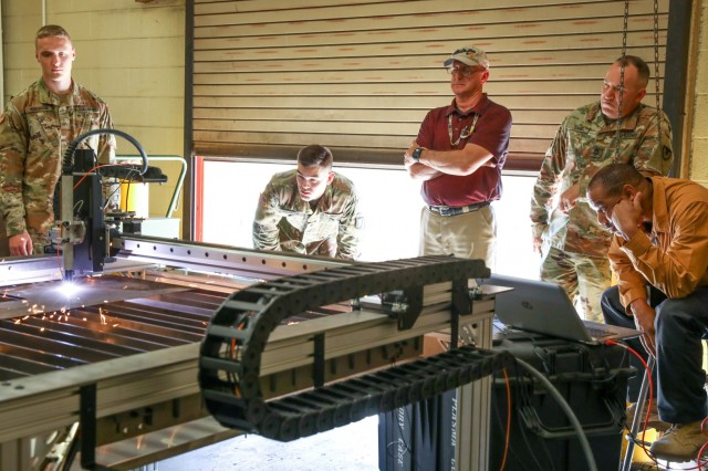 Soldiers of the 584th Maintenance Company, 129th Combat Sustainment Support Battalion, 101st Sustainment Brigade, 101st Airborne Division (Air Assault), and watch attentively as civilian engineering instructors demonstrate how to use the plasma cutter machine to cut through sheet metal. The plasma cutter is one of many pieces of equipment housed within the Metal Working and Machining Shop Set (MWMSS) given to the 584th Maint. Co., who base their operations out of Fort Campbell, Kentucky, April 3-12, 2019. The 584th Maint. Co. will be the first company within the 101st Abn. Div. to receive this new and innovative equipment. (U.S. Army photo by Staff Sgt. Caitlyn Byrne, 101st Sustainment Brigade Public Affairs)