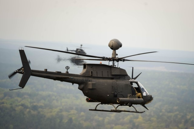 OH-58D Kiowa Warriors with the 1st Squadron, 17th Cavalry Regiment, 82nd Combat Aviation Brigade, conducted a flyover over the City of Fayetteville, N.C., April 15, 2016. The flyover served as the final flight of the squadrons Kiowa Warriors in mainland America. The U.S. Army looks to close a critical capability gap left when they divested of the Kiowa.