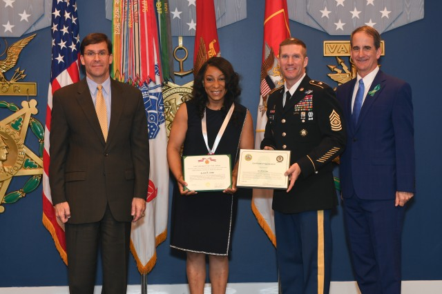 Alicia Case, USACE sexual assault response coordinator, center, poses with Secretary of the Army Mark Esper, left, Sergeant Major of the Army Daniel Dailey and James A. Helis, Director of the Army's Sexual Harassment/Assault Response and Prevention (SHARP), Ready and Resilient Directorate following a recognition ceremony April 23, 2019, in the Pentagon's Hall of Heroes.