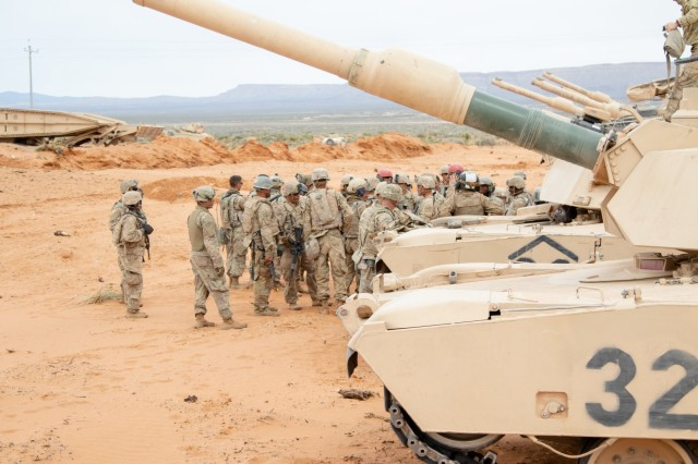 Soldiers assigned to 2nd Armored Brigade Combat Team, 1st Armored Division, prepare for an after-action review during exercise Strike Focus, at Orogrande Range Camp, N.M., April 12, 2019.
