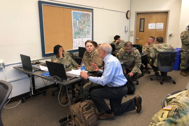 Dr. John Paciorek discusses the contract receipt and review process with Staff Sgt. Adriane Dunklin, left, and Sgt. 1st Class Renae Trujillo during a pilot course developing targeted content for leaders at the executive level March 12 at Joint Base Lewis-McChord. Paciorek is the professor of contract management at the Defense Acquisition University at Fort Belvoir, Virginia.