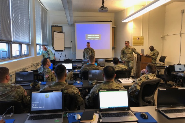Lt. Col. Rich Downs leads discussion on contingency contract administration services during a pilot training course developing targeted content for leaders at the executive level March 12 at Joint Base Lewis-McChord. The two-day course provided and overview of CCAS roles and responsibilities for battalion- and brigade-level leaders. Downs is a contract plans officer with the Army Contracting Command Operations, Plans and Training who is leading development of the course.