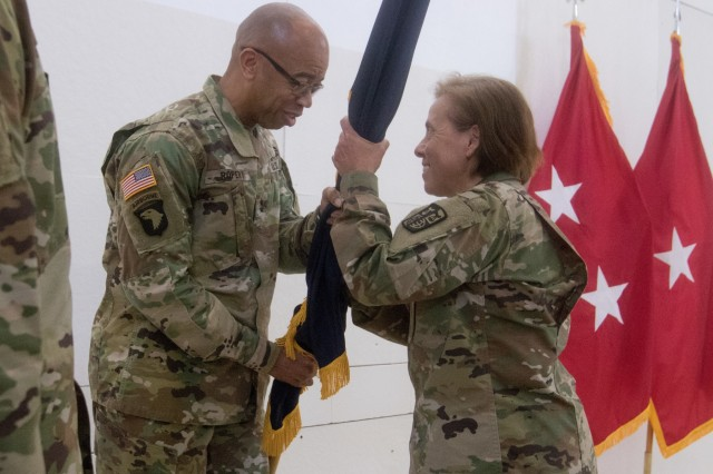 Maj. Gen. A.C. Roper, deputy chief of the U.S. Army Reserve, passes the command guidon to Brig. Gen. Marilyn Chiafullo as the incoming commander to U.S. Army Reserve Legal Command during a change of command ceremony April 24, Gaithersburg, MD. (U.S. Army Reserve photo by Maj. Jeku Arce, U.S. Army Reserve Legal Command)