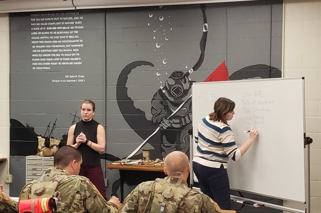 Deanna Morrison (left) and Dr. Kelly Dantin make a list of what a person physically feels when they are calm during a block of instruction for students of the Army Engineer Diver Phase I course. Morrison and Dantin are contractors with the Fort Leonard Wood R2 Performance Center.