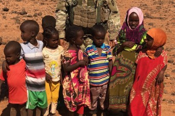 Soldier inspires donations, delivers 500 sandals to barefooted orphans