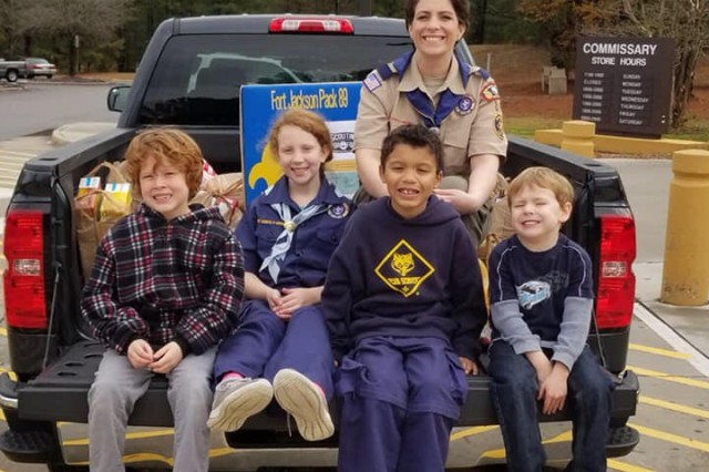 Fort Jackson Cub Scouts from Pack 89 help round up food for local, hungry youth during Commissary visits. For the last year, they have been contributing non-perishable food items to Richland Northeast High School's food bank for students who don't have enough to eat. Most of the donations have come from trips to the Commissary, where Scouts are allowed to solicit donations from shoppers from time to time.