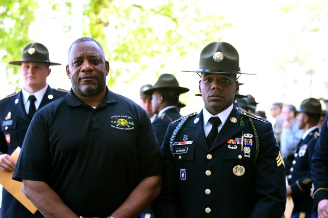 Retired Master Sgt. Dean Durham proudly stands with his son, Sgt. Donovan B. Durham, after the U.S. Army Drill Sergeant Academy graduation April 17 at Fort Jackson's post theater. Dean Durham is also an academy graduate who later became the deputy commandant of the school. Sgt. Durham is walking in his father's footsteps as he becomes a Fort Jackson drill sergeant.