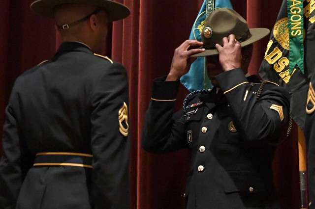 After completing Fort Jackson's U.S. Army Drill Sergeant Academy, Sgt. Donovan B. Durham dons the iconic campaign hat during a graduation ceremony April 17 at the post theater. Durham carries a Family tradition with him as he becomes a drill sergeant. His father, retired Master Sgt. Dean Durham, graduated the same academy and became the deputy commandant while stationed at Fort Jackson. Sgt. Durham wore the drill sergeant identification badge his father earned during the ceremony to honor his legacy.