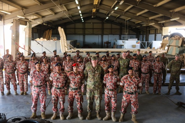 U.S. Army and Royal Army of Oman Soldiers pose for a photo during the Heavy Equipment Transporter System Subject Matter Exchange II held at Sultan bin Safy Camp Shafa Oman, April 6-11, 2019. (U.S. Army photo by Sgt. Nahjier Williams)