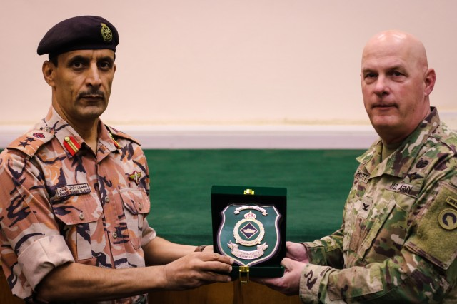 U.S. Army Col. Ahmed Suliman Al Badi, 1st Division Tank Commander, Royal Army of Oman Presents, Col. Rodney Honeycutt, 1st Theater Sustainment Command deputy commanding officer, with a token of appreciation during the Heavy Equipment Transporter System Subject Matter Exchange II held at Sultan bin Safy Camp Shafa Oman, April 6-11, 2019. (U.S. Army photo by Sgt. Nahjier Williams)