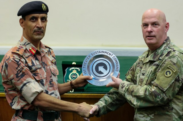 U.S. Army Col. Rodney Honeycutt, 1st Theater Sustainment Command deputy commanding officer, presents Col. Ahmed Suliman Al Badi, 1st Division Tank Commander, Royal Army of Oman, with a token of appreciation during the Heavy Equipment Transporter System Subject Matter Exchange II held at Sultan bin Safy Camp Shafa Oman, April 6-11, 2019. (U.S. Army photo by Sgt. Nahjier Williams)