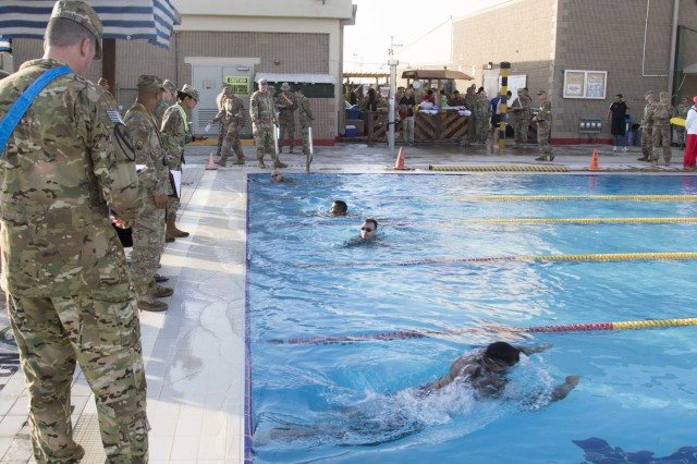 CAMP ARIFJAN, Kuwait - United States service members and coalition forces participate in the swim event of the German Armed Forces Badge (GAFB) for Military Proficiency on April 8, 2019, at Camp Arifjan, Kuwait. During this event, competitors must swim 100 meters in uniform within four minutes and then remove their uniform in the deep end without support. U.S. Army Central hosts events such as the GAFB to enhance service member's personal abilities to stay combat ready which improves overall capabilities. (U.S. Army Reserve photo by Sgt. Christopher Lindborg, U.S. Army Central Public Affairs Office)