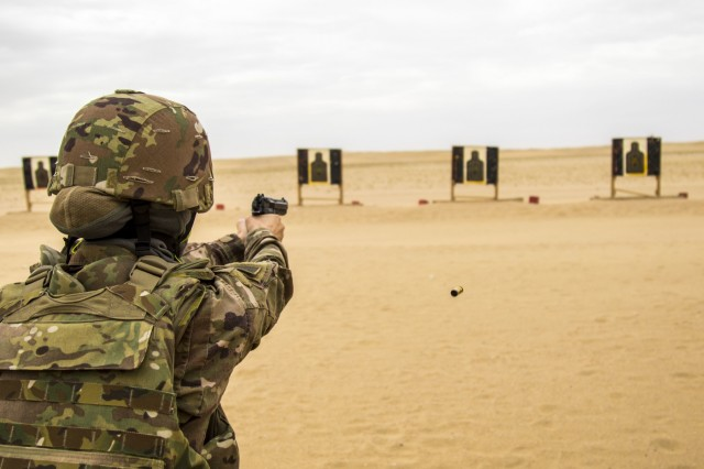 CAMP ARIFJAN, Kuwait - Army Staff Sgt. Danielle Reynolds, 637th Chemical, Biological, Radiological and Nuclear Company, shoots a Beretta M9 at targets during the range qualification event of the German Armed Forces Badge (GAFB) for Military Proficiency on April 9, 2019, at Udairi Range, Kuwait. During this event, participants stand and shoot a total of five rounds with a Beretta M9 at three silhouettes. Participants, who must hit each target at a minimum, shoot in order at targets one, two, three, one, two and earn bronze with three hits, silver for four hits and gold for five hits. U.S. Army Central hosts events such as the GAFB to enhance service member's personal abilities to stay combat ready which improves overall capabilities. (U.S. Army Reserve photo by Sgt. Christopher Lindborg, U.S. Army Central Public Affairs Office)