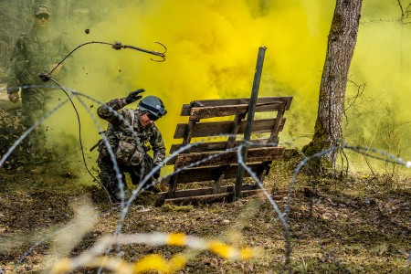 A Soldier assigned to Regional Health Command Europe uses the grappling hook to clear a wire obstacle during U.S. Army Europe Expert Field Medical Badge Combat Testing at Grafenwoehr Training Area, Germany, March 29, 2019. To qualify for the EFMB, Soldiers must endure a multitude of events such as land navigation, physical fitness test, medical evacuations, weapons function checks, ruck march, chemical biological radioactive nuclear evaluations, written test  and medical treatments.