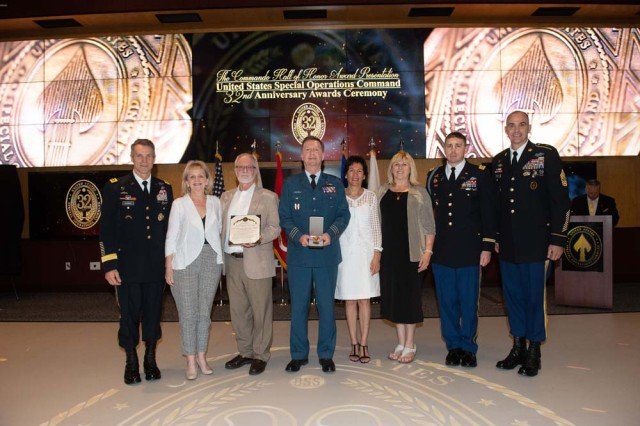 The Bangsboll family, flanked by USSOCOM Commander, General Richard D. Clark, and USSOCOM Command Sergeant Major Patrick L. McCauley, accept the award for LTC Leif Bangsboll, April 18, 2019