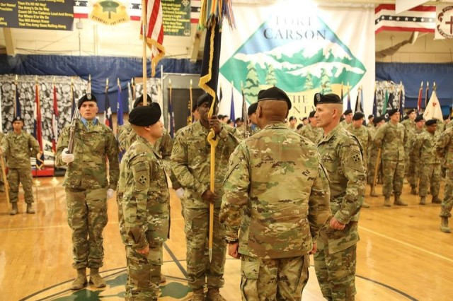 Command Sgt. Maj. Charles W. Tennant, Col. Monte Rone and Command Sgt. Maj. Delfin J. Romani, 1st Stryker Brigade Combat Team, 4th Infantry Division prepares to pass the organizational colors and res