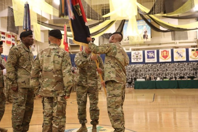 Command Sgt. Maj. Charles W. Tennant, Col. Monte Rone and Command Sgt. Maj. Delfin J. Romani, 1st Stryker Brigade Combat Team, 4th Infantry Division passes the organizational colors and responsibility