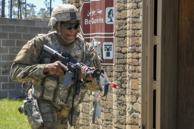 Georgia Army National Guardsman, Pvt. Gary Russell, enters a building as the squad begins to clear and establish a perimeter at Fort Stewart, Ga. on April 16, 2019. The unit is set to travel to the National Training Center at Fort Irwin in May.U.S. Army National Guard photo by Spc. Tori Miller.