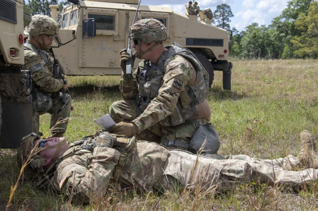 Georgia Army National Guardsman, Sgt. Joseph Bryan a military policeman with the Fort Stewart -based 179th Military Police Company, calls in a 9-line medivac of an injured non-combatant during a training exercise at Fort Stewart, Ga. on April 18, 2019. The unit trained on diverse tactical exercises in preparation for their rotation at the National Training Center at Fort Irwin in May.U.S. Army National Guard photo by Spc. Tori Miller.
