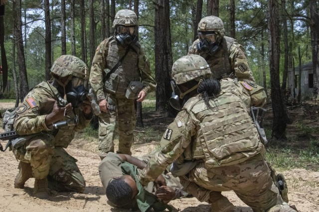 Soldiers of the Fort Stewart-based 179th Military Police Company gather information to assist the victim of a gas attack during training at Fort Stewart, Ga. on April 17, 2019. The unit trained of different chemical, biological, radioactive and nuclear attacks in preparation for their rotation at the National Training Center in May.U.S. Army National Guard photo by Spc. Tori Miller.