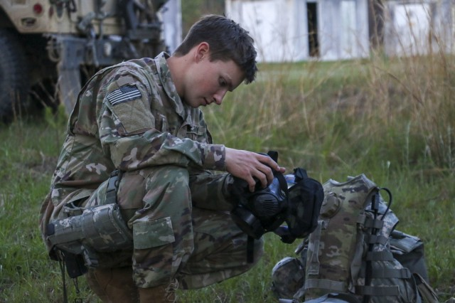 Georgia Army National Guardsman, Pfc. Randall Brown, takes a knee to adjust his gas mask during training at Fort Stewart, Ga. on April 16, 2019. The Fort Stewart-based 179th Military Police company is conducting additional training before attending their rotation at the National Training Center at Fort Irwin in May.U.S. Army National Guard photo by Spc. Tori Miller.