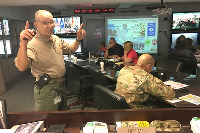 Randall (Mack) McPherson, the installation emergency manager on Fort Stewart-Hunter Army Airfield, discusses evacuation timelines and response guidelines, April 18, during an installation hurricane table-top exercise.