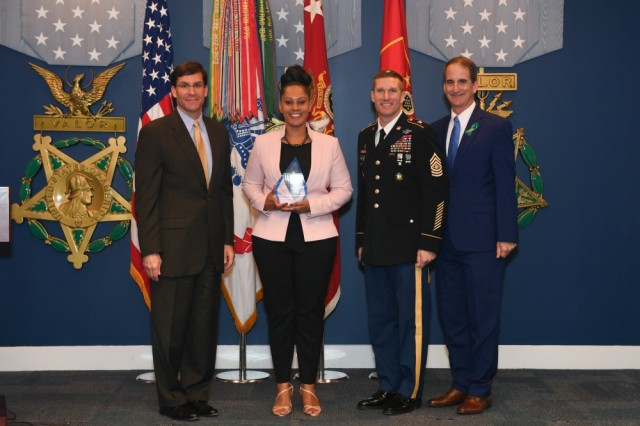 Retired Sgt. Maj. Tamika L. Wynn poses with Secretary of the Army Mark T. Esper, Sgt. Maj. of the Army Daniel A. Dailey, and SHARP Director Dr. James A. Helis during the Sexual Assault Awareness and Prevention Month Recognition Ceremony in the Hall of Heroes at the Pentagon in Arlington, Va., April 23, 2019. Wynn received the National Organization for Victim Assistance 2018 Exceptional Military Victim Advocate award.