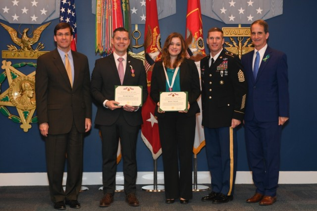 William E. Mottley and Rachel J. Phillips pose with Secretary of the Army Mark T. Esper, Sgt. Maj. of the Army Daniel A. Dailey, and SHARP Director Dr. James A. Helis during the Sexual Assault Awareness and Prevention Month Recognition Ceremony in the Hall of Heroes at the Pentagon in Arlington, Va., April 23, 2019. Mottley and Phillips received the 2018 DoD Recognition for Advancing Primary Prevention award.