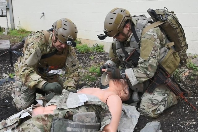 Instructors from the Tactical Combat Medical Care Course (TCMC) reenact a trauma scenario consisting of two segments - Care Under Fire and Tactical Field Care. The course is geared toward medical doctors, physician's assistants, nurses and senior medics in preparation for deployment to hostile environments. TCMC prepares students for potential injuries and wounds they might encounter on the battlefield. The intense 5-day course is offered several times a year at the Health Readiness Center of Excellence on Joint Base San Antonio-Fort Sam Houston. As the course increases instructors, they project an annual student throughput of up to 2,000 students per year to accommodate those units who have mandated the course as a pre-deployment requirement for their medical providers. Students from all branches of military service have attended the course however the majority are now from the U.S. Army.