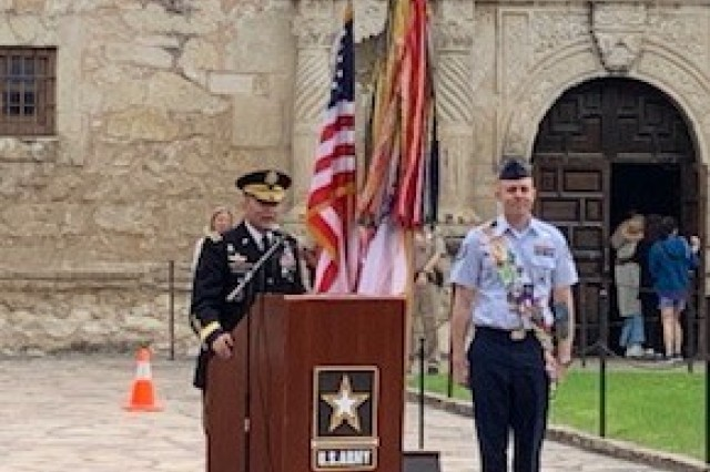 Lt. Gen. Jeffrey S. Buchanan, commanding general for U.S. Army North, recognizes Tech Sgt. Ryan Fillweber during the Army Day at the Alamo celebration, which was held April 23, for his actions during the April 22 Texas Cavaliers River Parade. Fillweber, a military ambassador during the 2019 Fiesta San Antonio celebrations, which last from April 18 to April 28, jumped off his barge and into the San Antonio River to save a woman who had fallen head-first into the river and was unable to right herself.