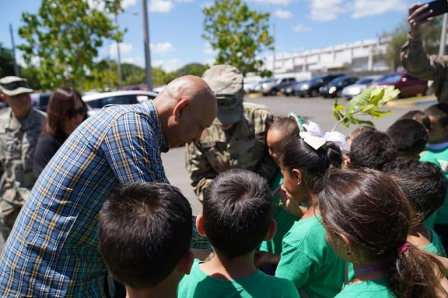 Brig. Gen. Dustin A. Shultz, senior federal Army officer in the Caribbean, and Command Sgt. Maj. Robert Breck, senior noncommissioned officer in the region, planted a fruit tree with students of the 4H club at the elementary school Eli Ramos Rosario, April 23, as a way to celebrate the 111th Army Reserve birthday, in direct connection with the local communities.