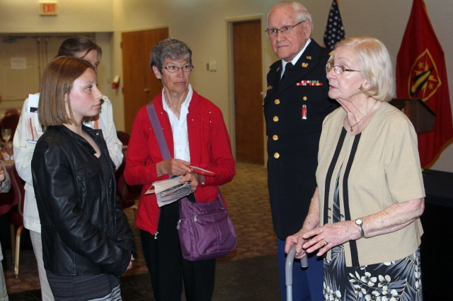"""Even after her speaking engagement at Fort Sill's """"Days of Remembrance"""" luncheon April 18, 2019, 89-year-old Holocaust survivor Zitta Wilkinson, right, had the stamina to satisfy the audience's hunger to know more, as her husband, retired CW4 Richard Wilkinson, waits patiently."""