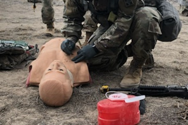 FORT CARSON, Colo. -- Candidate Pvt. 1st Class Dean Santos, a preventive medicine specialist from 4th Brigade Support Battalion, 1st Stryker Brigade Combat Team, 4th Infantry Division conducts hands-on needle chest decompression practice at Combat Testing Lane One at Fort Carson, Colo., Apr. 12, 2019.