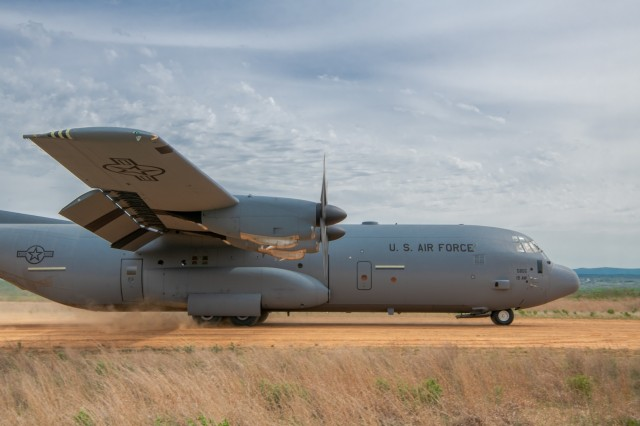 An Air Force C-130J Super Hercules assigned to 19th Airlift Wing, Little Rock Air Force Base, AR, touches down on a dirt runway at Fort Chaffee, Ark. during Operation Phantom Flight on April 12, 2019. Operation Phantom Flight is a joint service operation where both Soldier and Airmen worked alongside one another to successfully mobilize and transport Steel Warrior Battalions HIMARS from Henry Post Army Airfield, Okla., to Fort Chaffee, Ark., in order to successfully conduct an air/land raid.