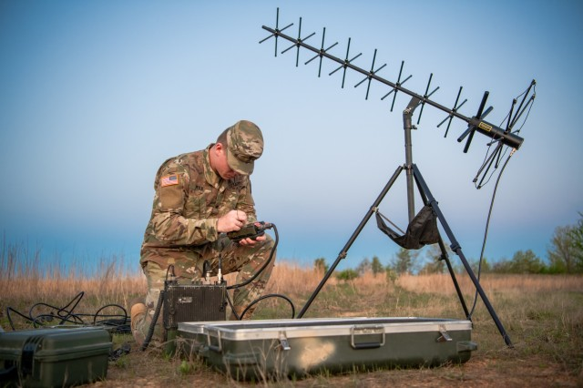 Spc. Adler Polk, a signal support system specialist assigned to 1st Battalion, 14th Field Artillery Regiment, 75th Field Artillery Brigade, Fort Sill, Okla., prepares the radio system used to allow all Soldiers and Airmen participating in Operation Phantom Flight to keep constant communications with one another in Fort Chaffee, Ark. on April 12, 2019. Operation Phantom Flight is a joint service operation where both Soldier and Airmen worked alongside one another to successfully mobilize and transport Steel Warrior Battalions HIMARS from Henry Post Army Airfield, Okla., to Fort Chaffee, Ark., in order to successfully conduct an air/land raid.