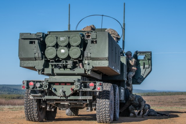 Soldiers of 1st Battalion, 14th Field Artillery Brigade, 75th Field Artillery Brigade, Fort Sill, Okla., prepares an M142 HIMARS after having arrived to Fort Chaffee, Ark., by an Air Force C-130J Super Hercules for Operation Phantom Flight on April 12, 2019. Operation Phantom Flight is a joint service operation where both Soldier and Airmen worked alongside one another to successfully mobilize and transport Steel Warrior Battalions HIMARS from Henry Post Army Airfield, Okla., to Fort Chaffee, Ark., in order to successfully conduct an air/land raid.