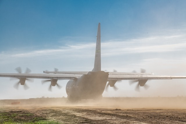 An Air Force C-130J Super Hercules assigned to 19th Airlift Wing, Little Rock Air Force Base, Ark., touches down on a dirt runway at Fort Chaffee, AR during Operation Phantom Flight on April 12, 2019. Operation Phantom Flight is a joint service operation where both Soldier and Airmen worked alongside one another to successfully mobilize and transport Steel Warrior Battalions HIMARS from Henry Post Army Airfield, Okla., to Fort Chaffee, Ark., in order to successfully conduct an air/land raid.