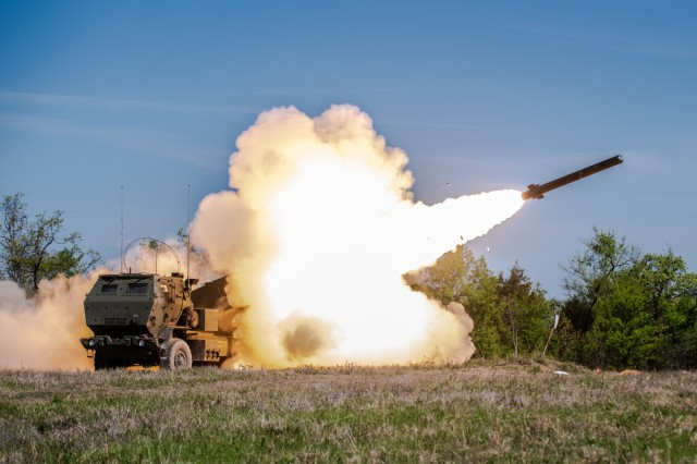 An M142 High Mobility Artillery Rocket System, or HIMARS, assigned to 1st Battalion, 14th Field Artillery Brigade, 75th Field Artillery Brigade, Fort Sill, Okla., fires the first of six rockets during Operation Phantom Flight at Fort Chaffee, Ark. during Operation Phantom Flight, April 12, 2019. Operation Phantom Flight is a joint service operation where both Soldier and Airmen worked alongside one another to successfully mobilize and transport Steel Warrior Battalions HIMARS from Henry Post Army Airfield, Okla., to Fort Chaffee, Ark., in order to successfully conduct an air/land raid.