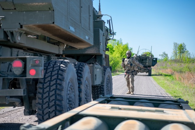Staff Sgt. Zacchaeus Butler, a launcher chief assigned to 1st Battalion, 14th Field Artillery Brigade, 75th Field Artillery Brigade, Fort Sill, Okla., ground guides an M142 HIMARS as it prepares to load addition missile pod during Operation Phantom Flight at Fort Chaffee, Ark. on April 12, 2019. Operation Phantom Flight is a joint service operation where both Soldier and Airmen worked alongside one another to successfully mobilize and transport Steel Warrior Battalions HIMARS from Henry Post Army Airfield, Okla., to Fort Chaffee, Ark., in order to successfully conduct an air/land raid.