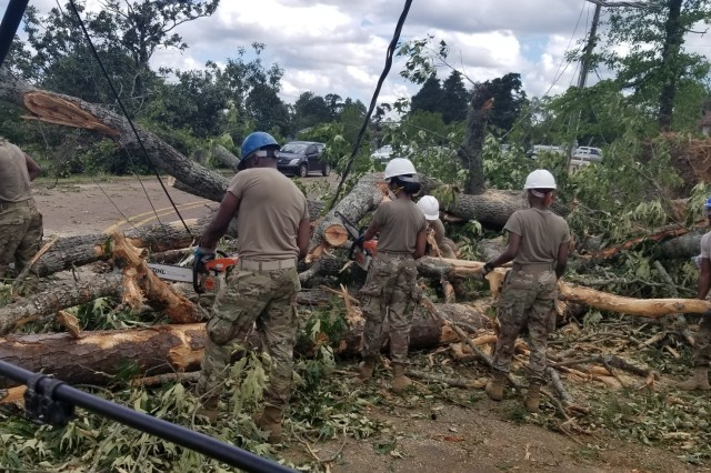 Louisiana National Guardsmen with the 527th Engineer Battalion, headquartered in Ruston, Louisiana, clean debris after tornados touched down in their community, April 25, 2019