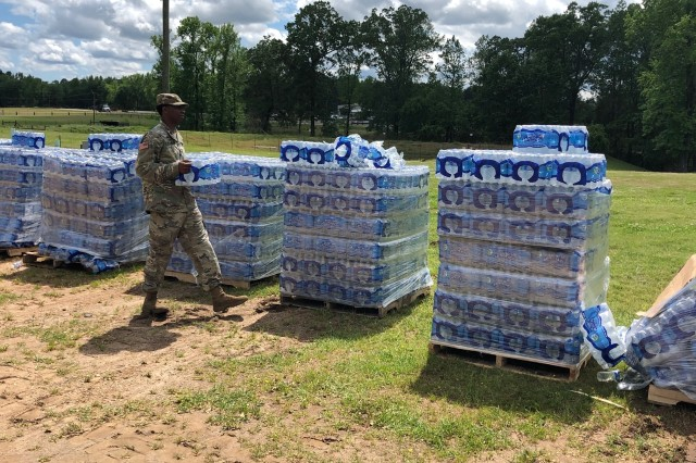 A Louisiana National Guardsman with the 527th Engineer Battalion stacks water after tornados touched down in Ruston, Louisiana, April 25, 2019.