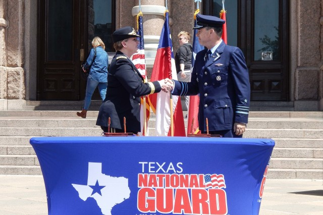 Adjutant General of Texas, Maj. Gen. Tracy Norris, shakes hands with a Chilean military official at the Texas State Capitol in Austin, Texas, April 12, 2019. the Texas National Guard and Chilean Armed Forces converged in Austin, Texas to discuss and celebrate their partnership that started one decade ago. As part of the annual State Partnership Program Planning meeting the parties met to discuss, plan and establish agreed upon activities, in both countries, for the year ahead. The events, held throughout the year, focus on disaster/emergency response; aviation operations, maintenance and safety; military medical and engineer activities; as well as leadership, staff, officer and noncommissioned officer development.