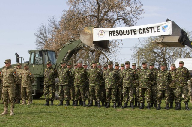 Romanian Land Forces service members stand in formation during the opening ceremony of Resolute Castle 2019 at Cincu Joint National Training Center, Romania, April 24, 2019. Resolute Castle is a multinational exercise conducted to improve training infrastructure and the interoperability between NATO allies.