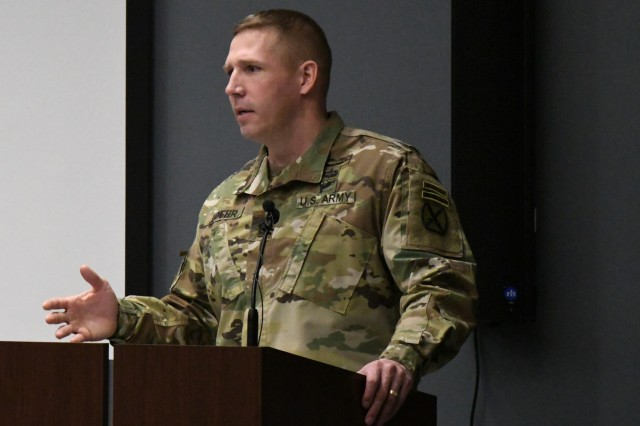 Command Sgt. Maj. Jeffrey Loehr, Fort Drum Noncommissioned Officer Academy commandant, addresses the audience at the ribbon-cutting ceremony April 25 for the new NCOA at Fort Drum, New York. The two-floor, 40,000 square foot building includes eight classrooms -- each can seat 20 students -- an 8,000 square foot indoor training facility, an auditorium that seats up to 206 occupants, a learning and resource center, barracks and an outdoor track. The next Basic Leader Course class will begin training at the new facility on April 29. (Photo by Mike Strasser, Fort Drum Garrison Public Affairs)