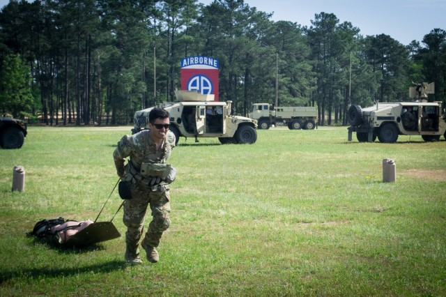 A Lieutenant assigned to the 3rd Brigade Combat Team, 82nd Airborne Division drags a litter April 25, 2019 on Fort Bragg's Pike Field during the brigade's annual Janney Cup competition.  The Janney Cup competition, held April 24 and 25 on Fort Bragg, North Carolina in honor of 1st. Lt. Richard Janney tested the physical endurance, mental grit and tactical knowledge of junior officers assigned to the brigade.